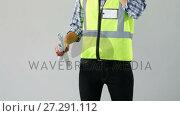 Купить «Male architect holding blue print and talking on mobile phone 4K 4k», видеоролик № 27291112, снято 20 марта 2019 г. (c) Wavebreak Media / Фотобанк Лори