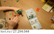 Купить «Ufa, Russian Federation - November 24, 2017 Child unpacks and builds Lego NEXO KNIGHTS  Combo NEXO power», видеоролик № 27294044, снято 24 ноября 2017 г. (c) Mikhail Erguine / Фотобанк Лори