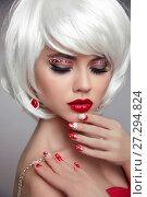 Купить «Christmas makeup. Red lips Make-up. Beautiful blond closeup portrait. Manicured nails. Jewelry. White Short bob hairstyle. Sensual blonde woman with xmas eye shadow. Vogue style.», фото № 27294824, снято 6 декабря 2017 г. (c) Photobeauty / Фотобанк Лори