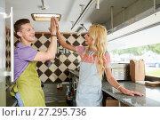 Купить «couple of sellers making high five at food truck», фото № 27295736, снято 1 августа 2017 г. (c) Syda Productions / Фотобанк Лори