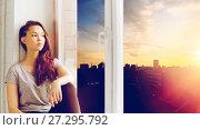 Купить «sad pretty teenage girl sitting on windowsill», фото № 27295792, снято 19 декабря 2015 г. (c) Syda Productions / Фотобанк Лори