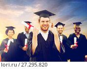 Купить «happy student with diploma celebrating graduation», фото № 27295820, снято 24 сентября 2016 г. (c) Syda Productions / Фотобанк Лори
