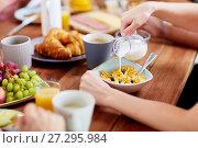 Купить «hands of woman eating cereals for breakfast», фото № 27295984, снято 5 октября 2017 г. (c) Syda Productions / Фотобанк Лори