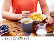Купить «close up of woman eating cereals with coffee», фото № 27295988, снято 5 октября 2017 г. (c) Syda Productions / Фотобанк Лори