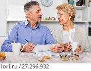Купить «Mature married couple discuss contract and sign important documents», фото № 27296932, снято 21 марта 2019 г. (c) Яков Филимонов / Фотобанк Лори