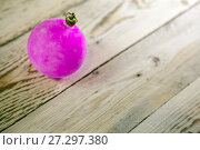 Pink New Year's ball on a wooden board, the small depth of sharpness. Стоковое фото, фотограф Куликов Константин / Фотобанк Лори