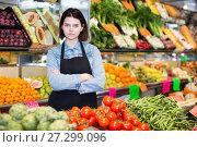 Female seller displaying assortment. Стоковое фото, фотограф Яков Филимонов / Фотобанк Лори