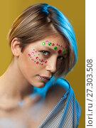 Купить «young woman with holiday makeup on her face», фото № 27303508, снято 12 декабря 2017 г. (c) Владимир Мельников / Фотобанк Лори