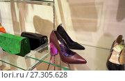 Купить «Sale collection of footwear and accessories with discount 50 percent», видеоролик № 27305628, снято 6 февраля 2017 г. (c) Курганов Александр / Фотобанк Лори