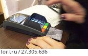 Купить «Customer enter code at credit card payment terminal», видеоролик № 27305636, снято 7 февраля 2017 г. (c) Курганов Александр / Фотобанк Лори