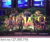 Купить «Poster of Jumanji: Welcome to the Jungle in Bangkok», фото № 27305716, снято 13 декабря 2017 г. (c) Александр Подшивалов / Фотобанк Лори