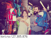 Купить «Couple choosing rucksack in store», фото № 27305876, снято 24 февраля 2017 г. (c) Яков Филимонов / Фотобанк Лори