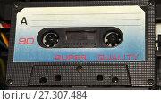 Купить «vintage orange audio cassette tape with a blank label», видеоролик № 27307484, снято 12 апреля 2017 г. (c) Курганов Александр / Фотобанк Лори