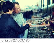 Купить «Couple visiting flea market», фото № 27309180, снято 23 октября 2017 г. (c) Яков Филимонов / Фотобанк Лори