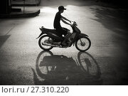 Купить «Man on a scooter in the streets of Lao Cai, North Vietnam.», фото № 27310220, снято 14 ноября 2016 г. (c) age Fotostock / Фотобанк Лори