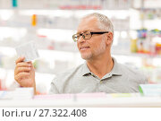 Купить «senior male customer with drug at pharmacy», фото № 27322408, снято 27 июня 2015 г. (c) Syda Productions / Фотобанк Лори