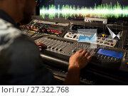 Купить «sound engineer at recording studio mixing console», фото № 27322768, снято 18 августа 2016 г. (c) Syda Productions / Фотобанк Лори