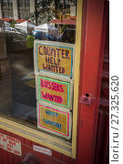 Купить «A sign in the window of a restaurant in New York advertises for workers, and its shortage of staff, on Monday, September 4, 2017. (© Richard B. Levine).», фото № 27325620, снято 4 сентября 2017 г. (c) age Fotostock / Фотобанк Лори