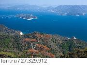 Купить «Fine clear day for looking at the Shikoku Mountain Range and the dotted island of Seto Inland Sea from Shishiiwa observatory. The Itsukushima (Miyajima) island, Japan», фото № 27329912, снято 13 апреля 2013 г. (c) Кекяляйнен Андрей / Фотобанк Лори