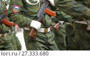 Купить «DONETSK, UKRAINE- 9 May 2017: soldiers walking by the street», видеоролик № 27333680, снято 26 мая 2017 г. (c) Илья Шаматура / Фотобанк Лори