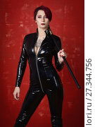 Купить «Beautiful fetish model in latex costume», фото № 27344756, снято 26 октября 2017 г. (c) Дмитрий Черевко / Фотобанк Лори