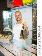 Купить «young female seller in bijouterie store», фото № 27346984, снято 20 апреля 2019 г. (c) Яков Филимонов / Фотобанк Лори