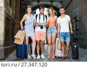 Купить «Group of young traveling people using paper map in city», фото № 27347120, снято 22 июня 2017 г. (c) Яков Филимонов / Фотобанк Лори