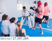 Купить «man training new taekwondo holds with adults during class», фото № 27347284, снято 8 апреля 2017 г. (c) Яков Филимонов / Фотобанк Лори
