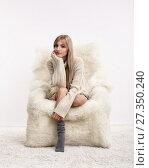 Купить «Blonde woman on furry arm-chair», фото № 27350240, снято 8 октября 2017 г. (c) Serg Zastavkin / Фотобанк Лори
