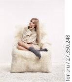 Купить «Blonde woman on furry arm-chair», фото № 27350248, снято 8 октября 2017 г. (c) Serg Zastavkin / Фотобанк Лори