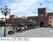 Купить «YEREVAN, ARMENIA – October 12, 2016: People walk on a sunny day at the central Republic Square, fountain, water,», фото № 27353732, снято 12 октября 2016 г. (c) Анна Мартынова / Фотобанк Лори