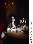 Купить «Evil witch in a dark room», фото № 27354524, снято 27 октября 2017 г. (c) Дмитрий Черевко / Фотобанк Лори