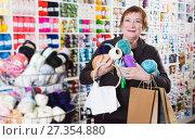 Купить «Woman with accessories for needlework», фото № 27354880, снято 10 мая 2017 г. (c) Яков Филимонов / Фотобанк Лори
