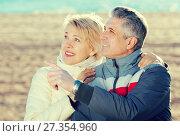 Купить «Mature couple walks outdoors and point by hand», фото № 27354960, снято 18 августа 2018 г. (c) Яков Филимонов / Фотобанк Лори