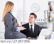 Купить «Businesswoman seducing male colleague», фото № 27357956, снято 20 апреля 2017 г. (c) Яков Филимонов / Фотобанк Лори