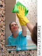 Купить «Charming woman doing cleaning», фото № 27358472, снято 10 ноября 2017 г. (c) Pavel Biryukov / Фотобанк Лори