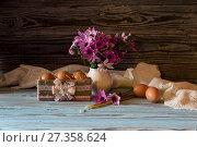 Купить «The easter composition. Eggs, a bouquet of wild anemones and church candles on wooden table close-up.», фото № 27358624, снято 8 января 2018 г. (c) Татьяна Ляпи / Фотобанк Лори