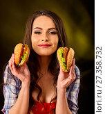 Woman eating hamburger. Girl bite of very big burger. Стоковое фото, фотограф Gennadiy Poznyakov / Фотобанк Лори