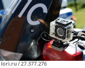 Купить «Видеорегистратор на полицейском мотоцикле ДПС», фото № 27377276, снято 12 августа 2017 г. (c) Free Wind / Фотобанк Лори