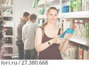 Купить «woman choosing detergent at a household goods in the store», фото № 27380668, снято 13 апреля 2017 г. (c) Яков Филимонов / Фотобанк Лори