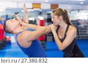Купить «Young woman and her trainer are practicing captures», фото № 27380832, снято 21 августа 2017 г. (c) Яков Филимонов / Фотобанк Лори