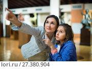 Купить «Mother and daughter enjoying expositions of previous centuries», фото № 27380904, снято 23 февраля 2018 г. (c) Яков Филимонов / Фотобанк Лори
