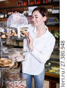 Купить «Woman choosing dessert», фото № 27380948, снято 24 января 2017 г. (c) Яков Филимонов / Фотобанк Лори