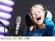 Купить «Regording studio. Child girl singing or role voicing», фото № 27381348, снято 8 января 2018 г. (c) Дмитрий Калиновский / Фотобанк Лори