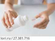 Купить «woman pouring syrup from bottle to medicine cup», фото № 27381716, снято 27 сентября 2017 г. (c) Syda Productions / Фотобанк Лори
