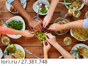 Купить «group of people eating at table with food», фото № 27381748, снято 5 октября 2017 г. (c) Syda Productions / Фотобанк Лори