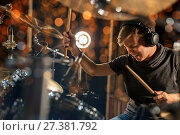 Купить «male musician playing drum kit at concert», фото № 27381792, снято 18 августа 2016 г. (c) Syda Productions / Фотобанк Лори