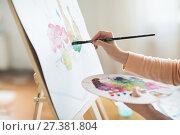 Купить «artist with palette painting at art studio», фото № 27381804, снято 1 июня 2017 г. (c) Syda Productions / Фотобанк Лори
