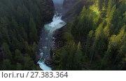 Купить «River flowing through green cliff 4k», видеоролик № 27383364, снято 19 июля 2019 г. (c) Wavebreak Media / Фотобанк Лори