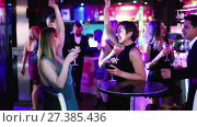 Купить «Colleagues dancing on corporate party with cocktails in hands», видеоролик № 27385436, снято 4 мая 2017 г. (c) Яков Филимонов / Фотобанк Лори